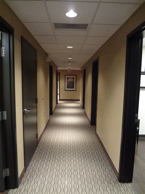 rug doctor corporate office hallway of office with carpet custom stained oak doors and recessed can lighting