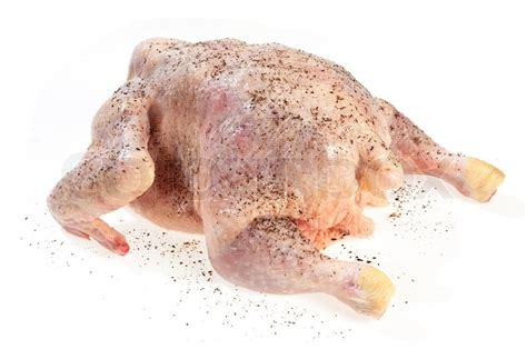 how do you cook capon chicken chicken sprinkled ground black pepper ready for cooking on white background stock