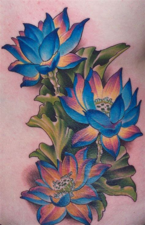 this is my first tattoo 3 lotus flowers located on my