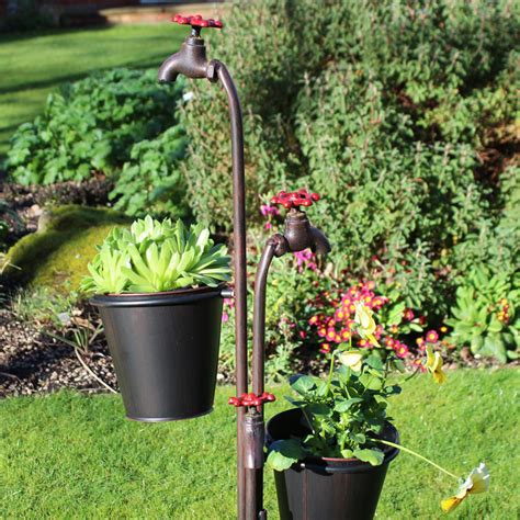 Metal Garden Planters by Metal Tap Garden Planter With Plant Pots