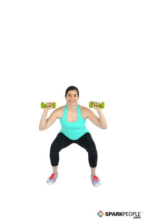 dumbbell squat with overhead press exercise demonstration