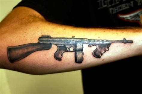 machine gun tattoo designs 30 cool gun tattoos desiznworld