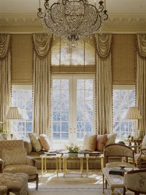 different window treatments use of the same window treatments throughout a room on different size windows unifies the space