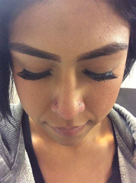 tattoo parlor and piercing near me body piercing done by esmeralda double nose piercing