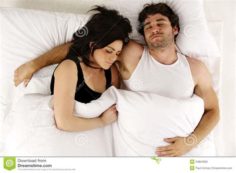how to cuddle with a guy in bed man and woman laid in white bed asleep cuddling royalty free stock images image