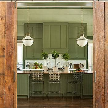 ebony wood sage green shaker door kitchen cabinet with barn doors in kitchen country kitchen hutker architects