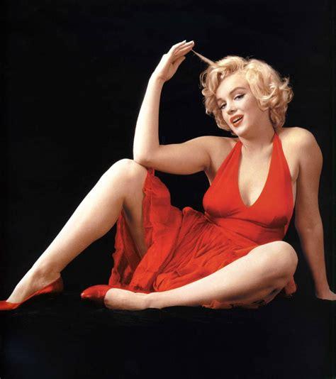 marilyn monroe marilyn monroe red sweater sitting feb 1955 vintage