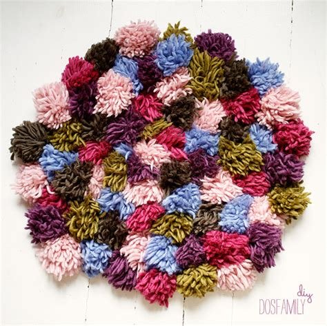 diy yarn rug make really easy yarn pompoms and then a rug out of them a dosfamily diy dos family