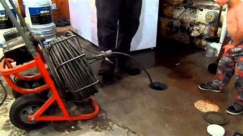 How to use a sewer snake to unplug a clogged drain pipe