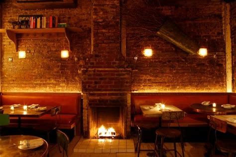 stay warm at nyc s best restaurants with fireplaces