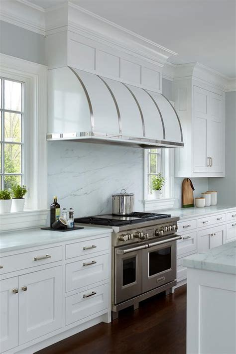 small white kitchen with steel hood black steel kitchen hood with white cabinets