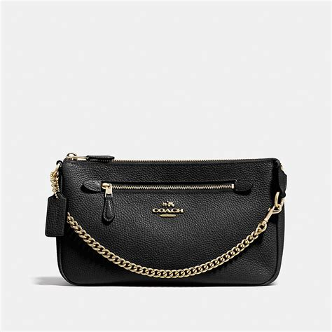 Clucth Coach coach nolita wristlet 24 in polished pebble leather