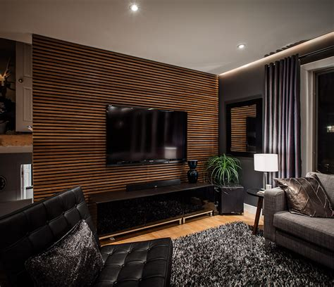 wood walls in living room living room grating shaped wood feature wall living room focal point ideas using feature