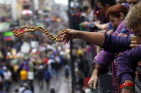 throwing at mardi gras images of mardi gras revelry the eye