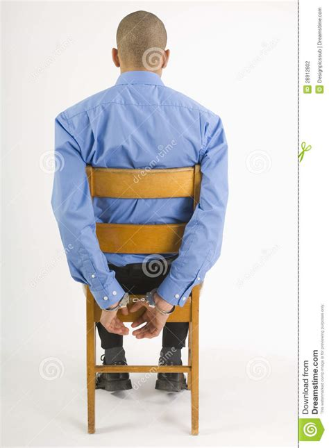 Handcuffed Chair by Sitting On Of A Picture Royalty Free