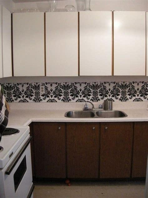 previous kitchen makeover with contact paper before and the dollar store rental kitchen makeover again dollar