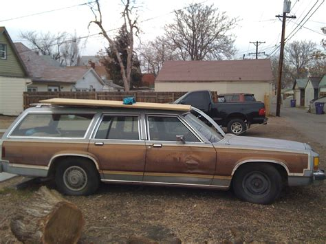 green station wagon with wood paneling station wagon