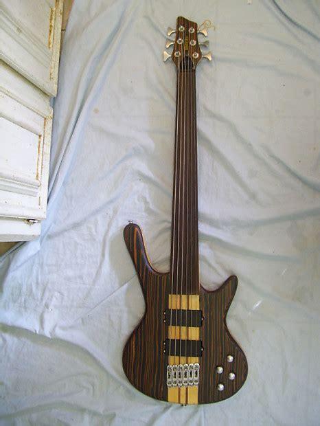 fretless bass guitar  string zebra wood neck