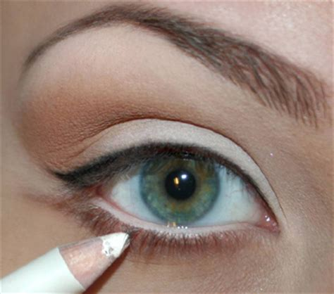 brown tattoo eyeliner white shadow on lid light brown in crease of eye a