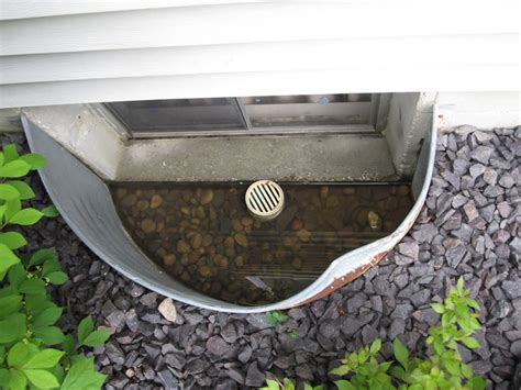 Dehumidifiers For Basement by How To Keep Your Basement Dry With Window Well Drains In