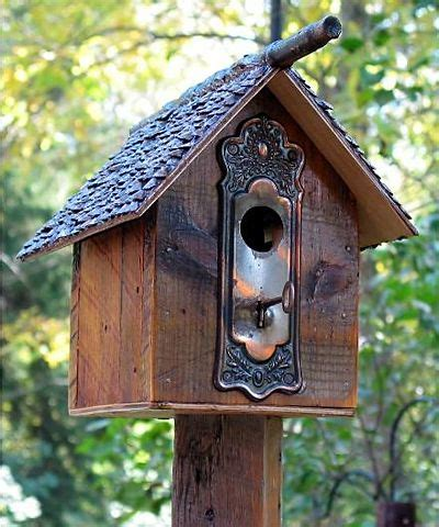 birdhouse made by recycled antique material it has a