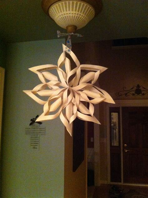 paper snowflakes hanging from ceiling