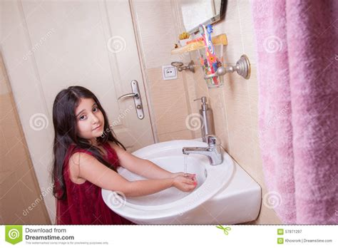 girls changing dress in bathroom little girl in eastern dress royalty free stock image