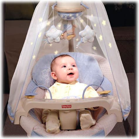 boy baby swings switch on the magical starry light show that projects