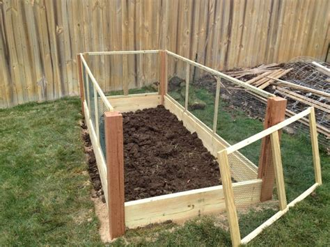 raised garden bed with fence pin by laura ambrogi on gardening pinterest