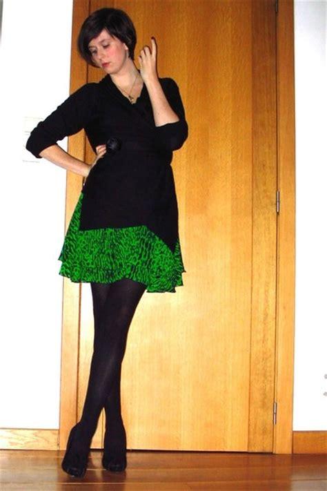 green dresses black sweaters black tights black shoes