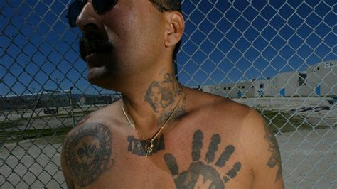 hand tattoo gang dozens indicted after three l a gangs unify under mexican