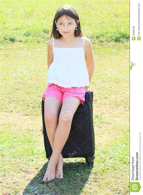 little girl up shorts girl sitting on suitcase stock photo image of white