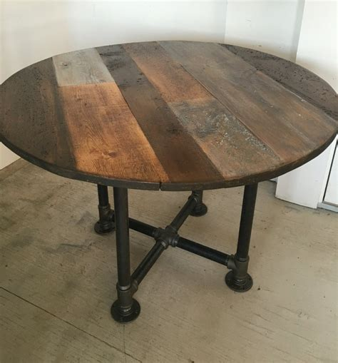 reclaimed wood round table round table dining tablepipe leg base reclaimed wood planks