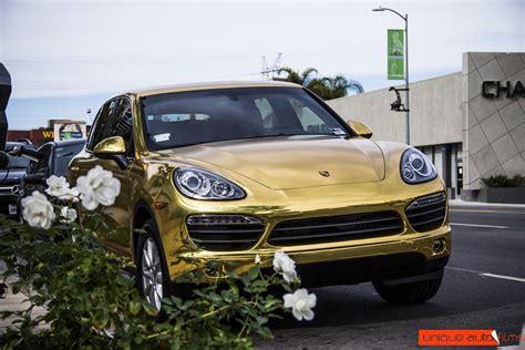 gold porsche truck project 24k gold porsche cayenne gold chrome vinyl wrap