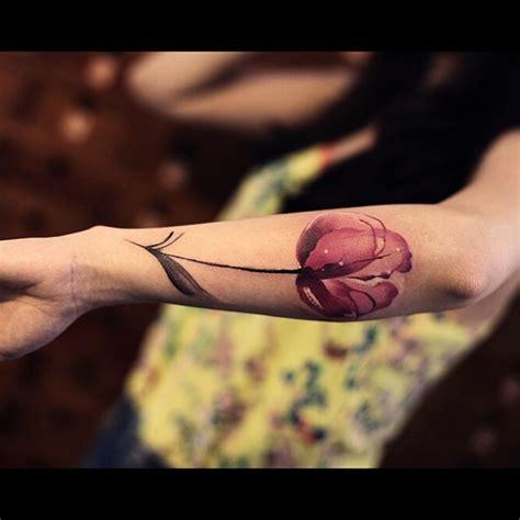 tattoo on pinks arm tender pink flower tattoo on arm best tattoo ideas gallery