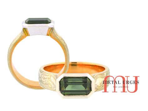 emerald cut australian green sapphire and mokume gane