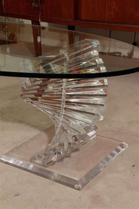 modern lucite and glass coffee table with spiral colume