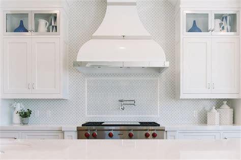 kitchen range backsplash brown kitchen island with turquoise blue counter stools