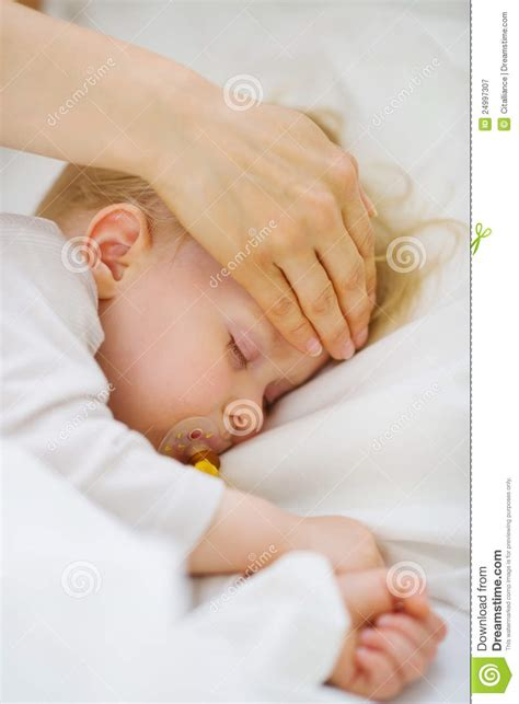 house temperature for baby closeup on mother checking temperature of baby royalty free stock photography image