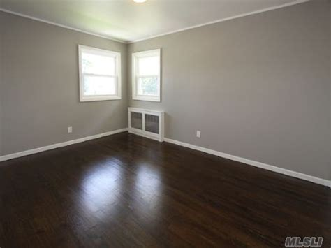 Grey Walls With Wood Floors by Grey Walls White Molding Wood Floor Home Home