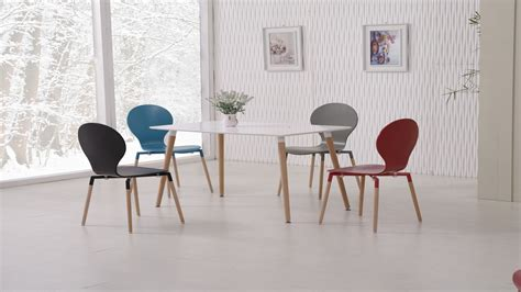 white dining table and mix colour chairs homegenies