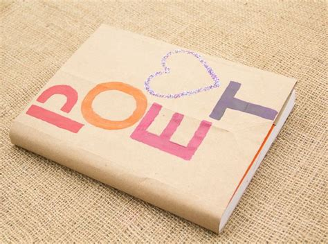 A Book Cover Out Of A Paper Bag - diy paper bag book cover moonfrye book covers