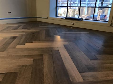 herringbone french oak hardwood floor installation in