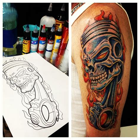 skull and piston tattoos flaming piston skull on left bicep tattooshunt com