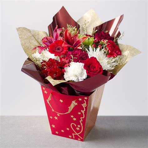 merry christmas gift bag send christmas flowers bunchescouk