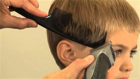 cutting boy hair with scissors boy s haircut how to cut a traditional side part boy s