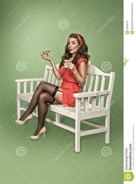 bench drinking girl in retro style drinks tea with cake royalty free