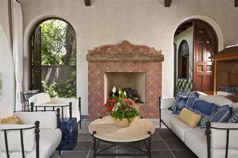 Mediterranean fireplace designs porch southwestern with fireplace mantel spanish tile dark floor