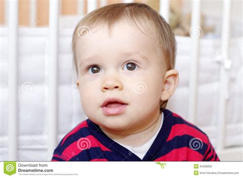 portrait of lovely baby boy age of 1 year against white