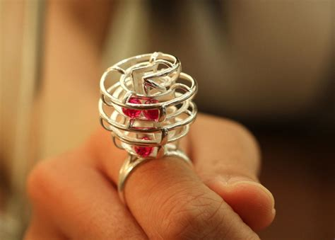 3d printed kinetic ring with ruby spheres contains